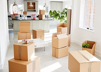 Stacked removals boxes in an empty room