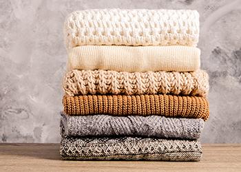 Pile of folded knitwear