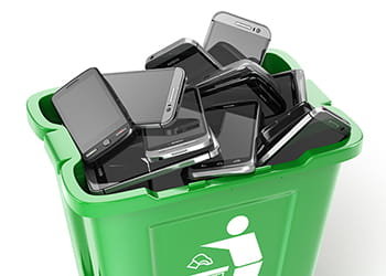 recycling bin filled with old mobile phones