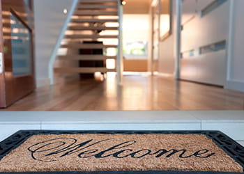 welcome mat at the door of a newly renovated home