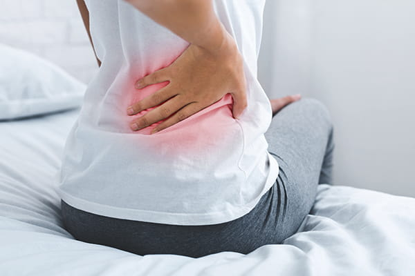 What causes non-specific back pain?