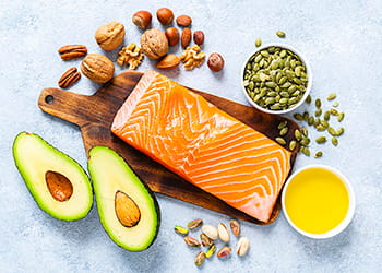 range of food with healthy fats avocado, salmon, nuts