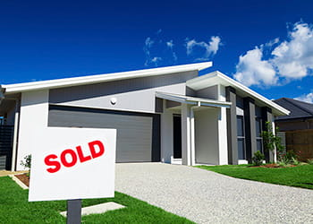 Home with a sold sign