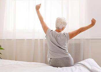 Senior woman waking and stretching