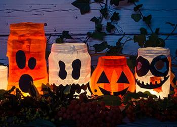 Homemade ghost and pumpkin Halloween jar lanterns