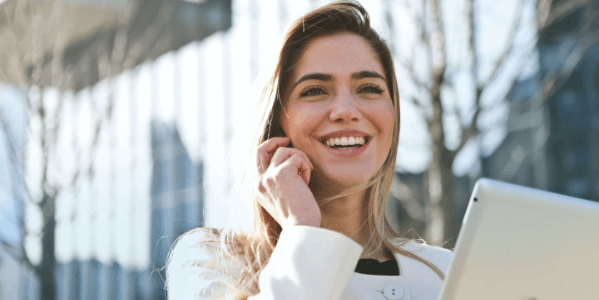 Woman smiling and talking on the phone.