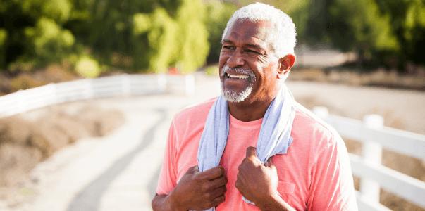 Older man outside exercising.