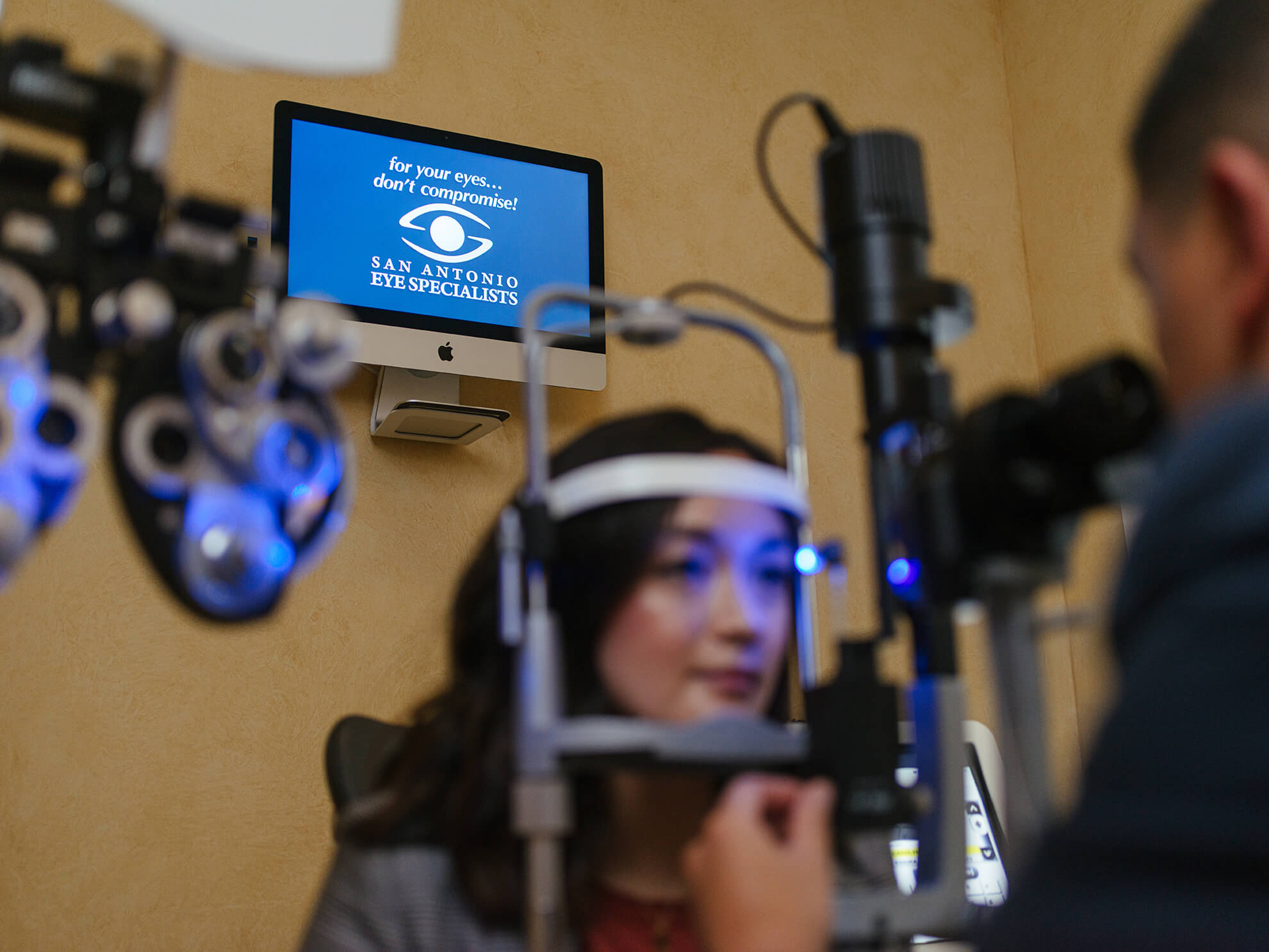Woman having her eyes examined at San Antonio Eye Specialists
