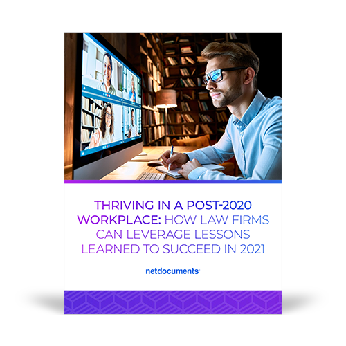 Graphic for the Whitepaper discussing law firms post-2020 world; a man sits at a computer desk smiling while working