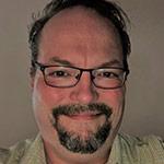 Imagem de close-up de Jobst Elster, chefe de estratégia de conteúdo e mercado jurídico da InsideLegal e vice-presidente da Envision Agency.