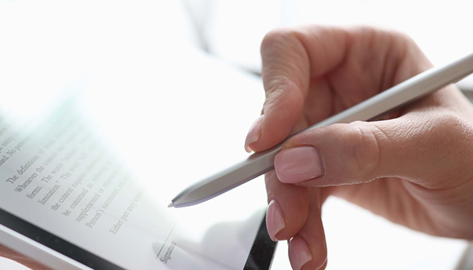 Close-up image of a hand typing on a laptop with folder icons hovering above.