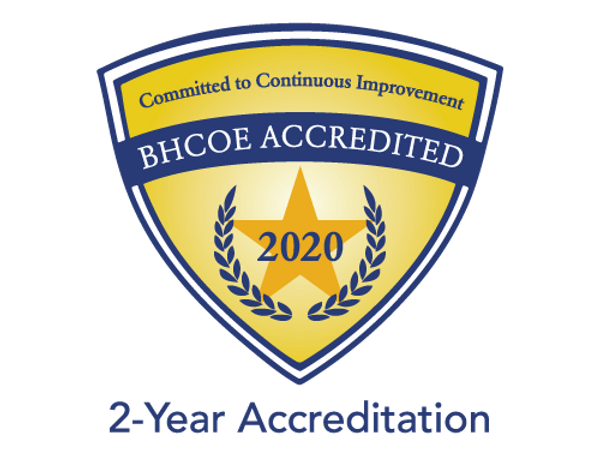 BHCOE Accreditation logo. Reads: Committed to Continuous Improvement. BHCOE Accredited 2020. 2-year Accreditation