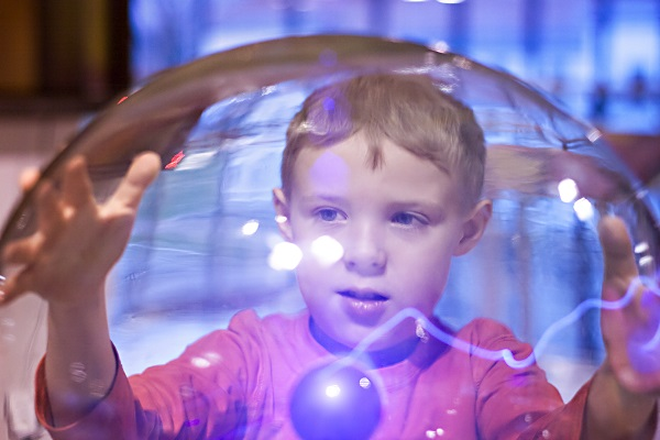 Child With Tesla Ball