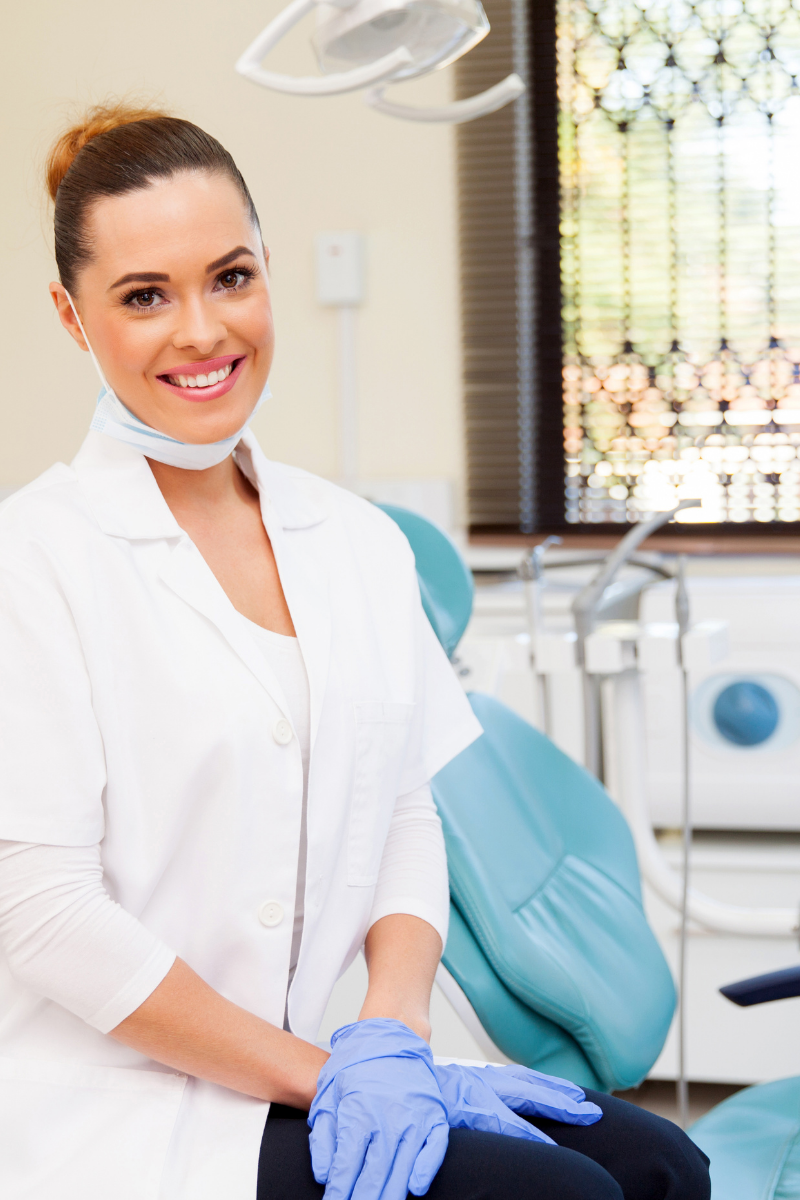 female-dentist-smiling-operatory