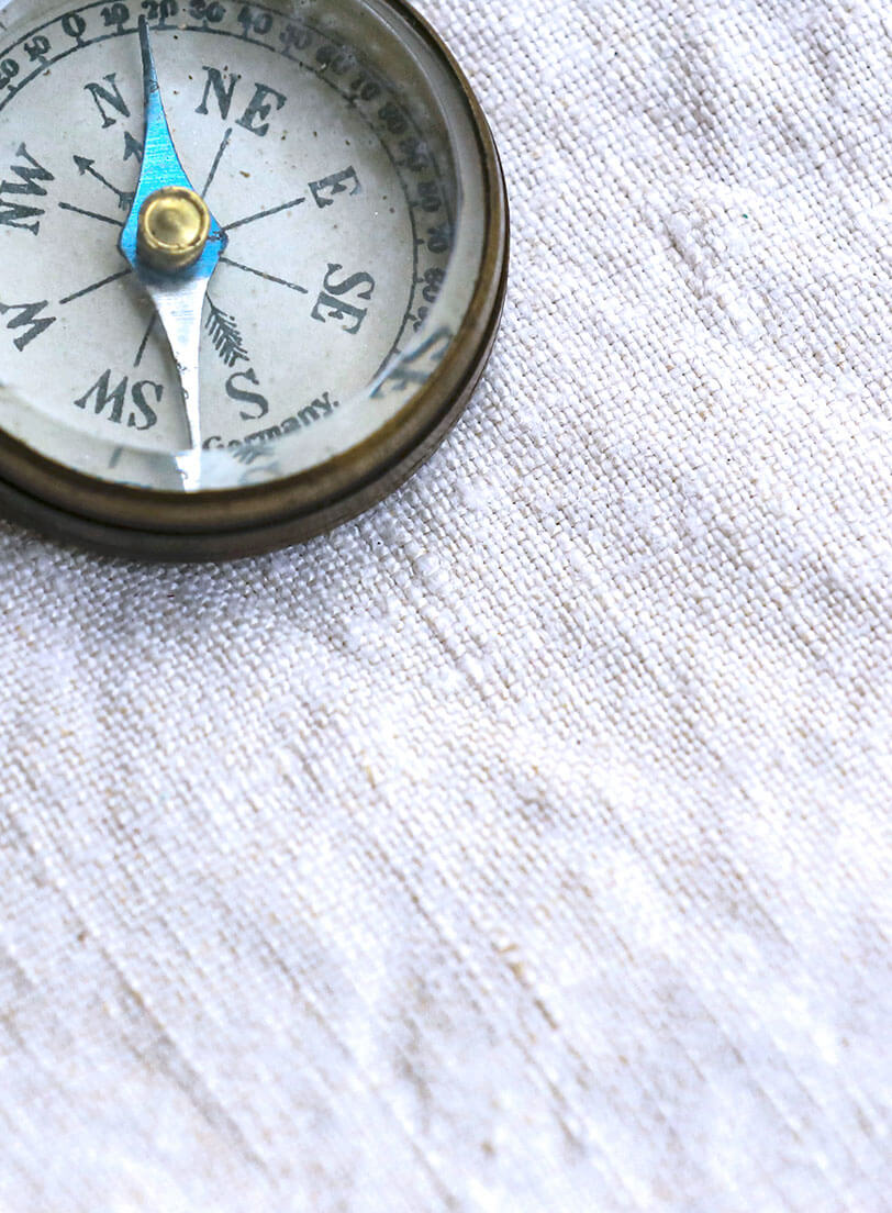 compass on a wrinkled piece of white paper