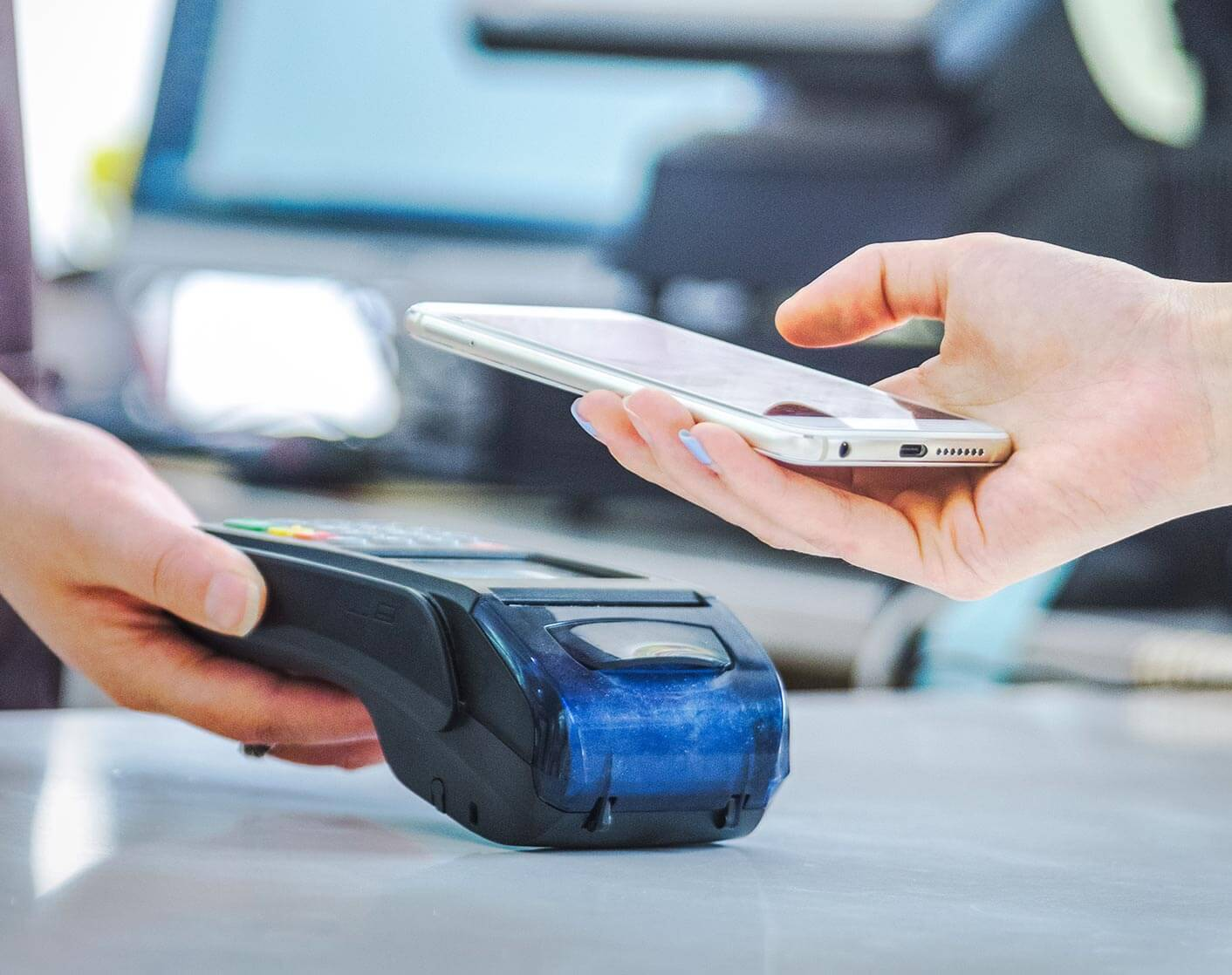 person using mobile wallet on debit credit pin pad