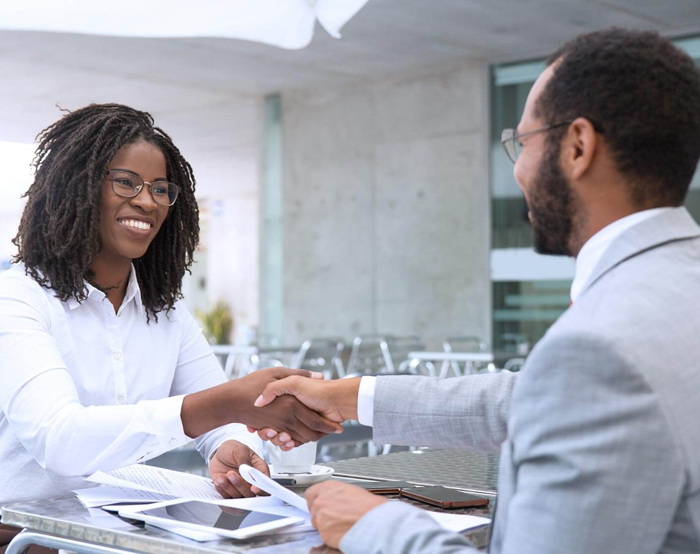 black woman shaking hands with black man