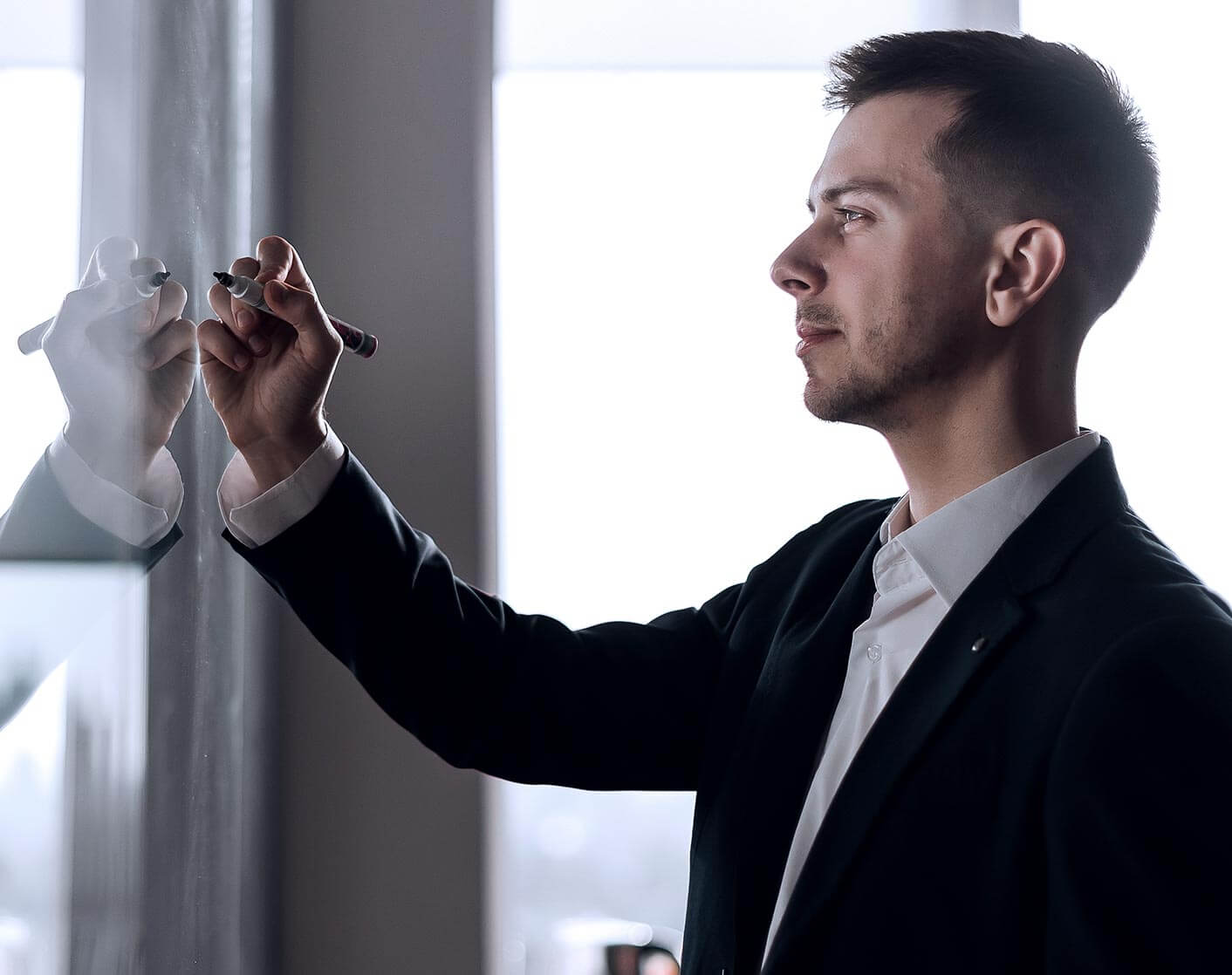 white business man writing on a white board