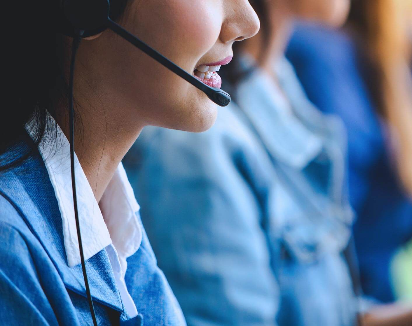 Asian woman with headset working in online support office