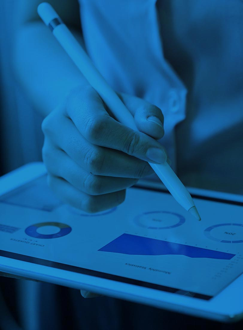 white woman using stylus on a tablet screen showing data dashboard blue filter over image