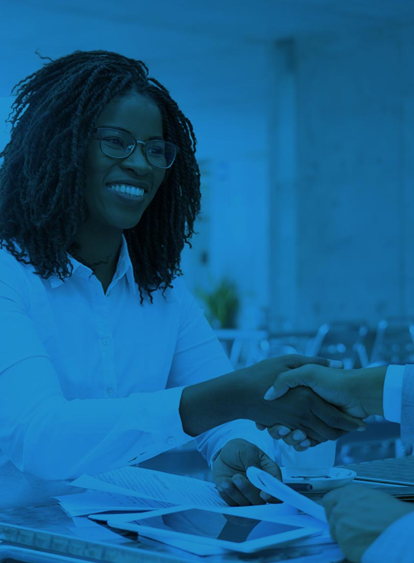 Black woman in white shirt shaking hands with another person blue filter over image