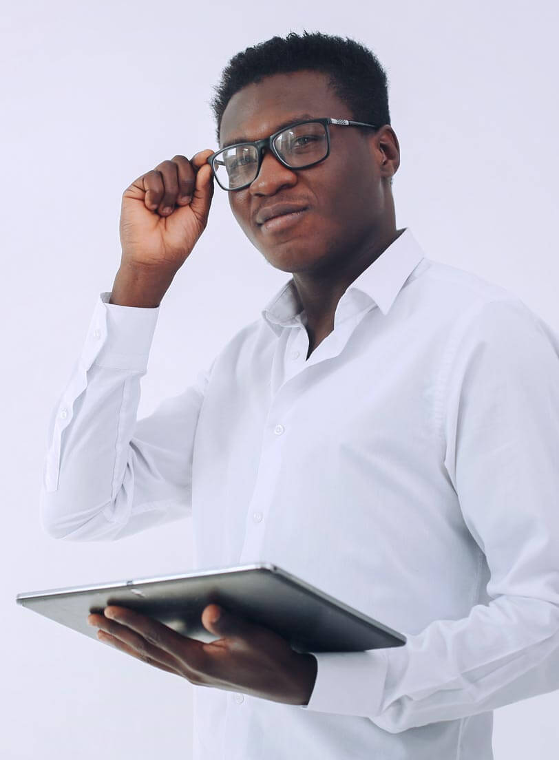 black man in white shirt adjusting his glasses while holding a tablet over it