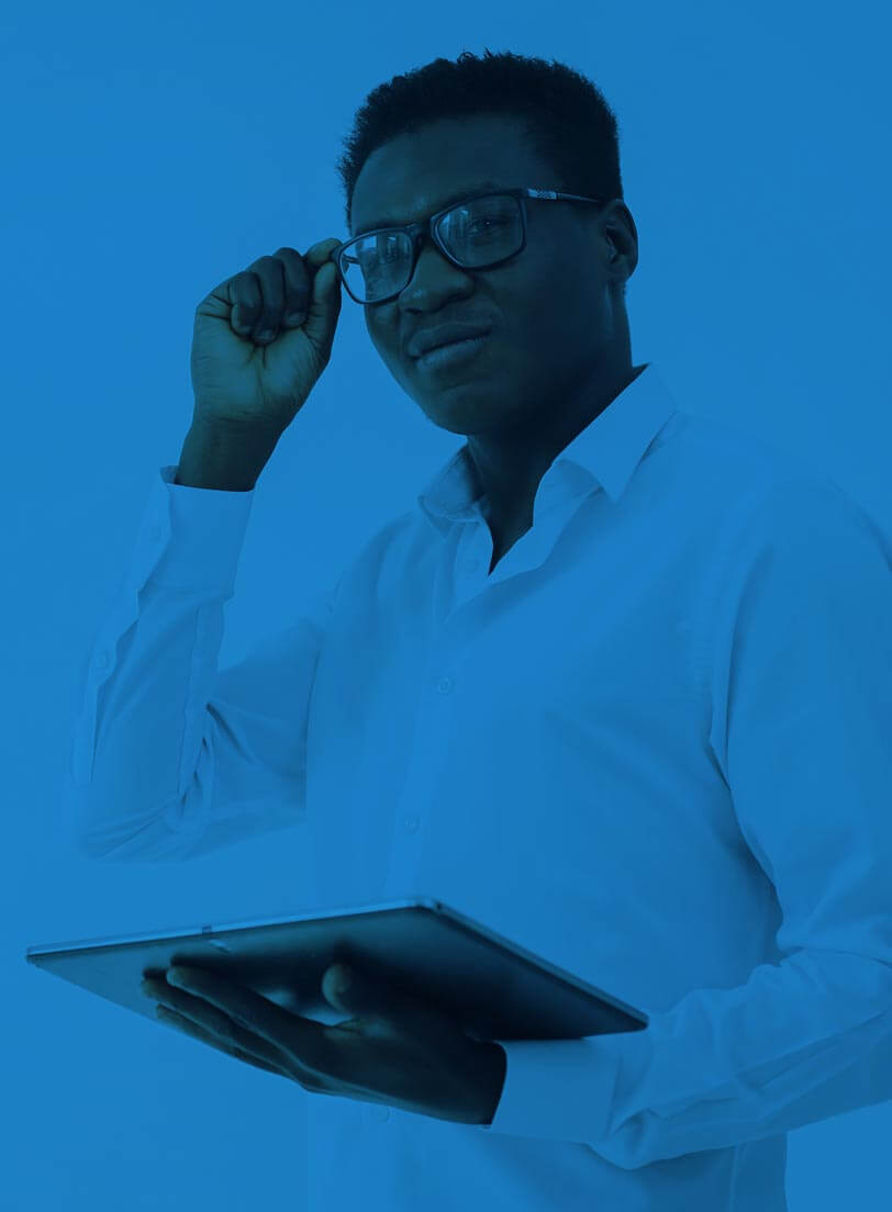 black man in white shirt adjusting his glasses while holding a tablet over it blue filter over image