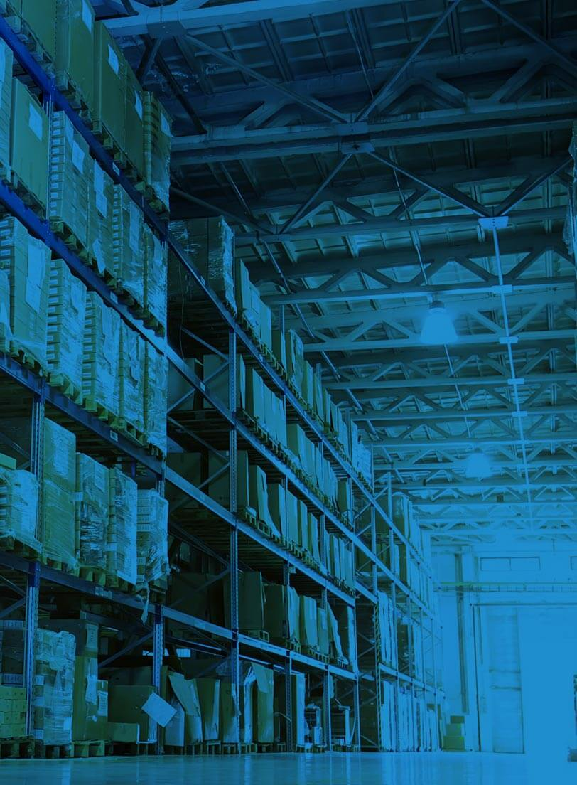 boxes on shelves in warehouse blue filter over image