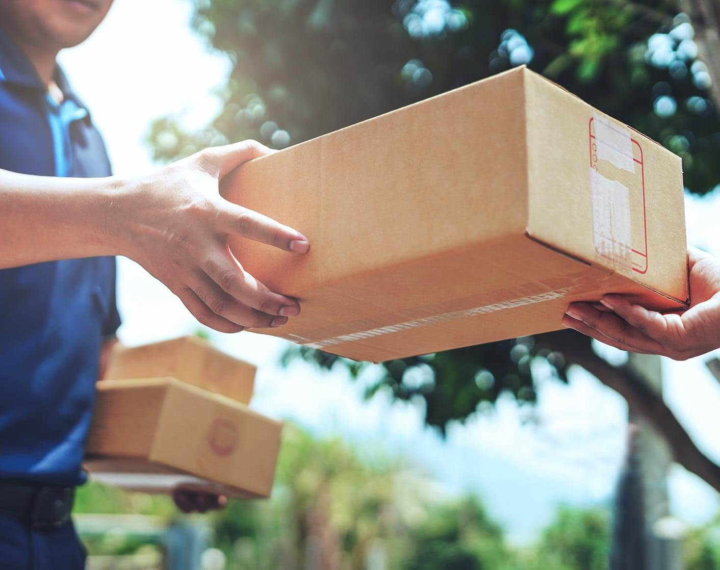 close up of one person handing a box to another person
