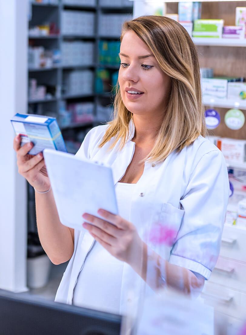Pharmacist checking prescription in a pharmacy