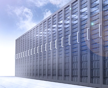 Image of computer server farm outside with a blue sky and fluffy clouds above