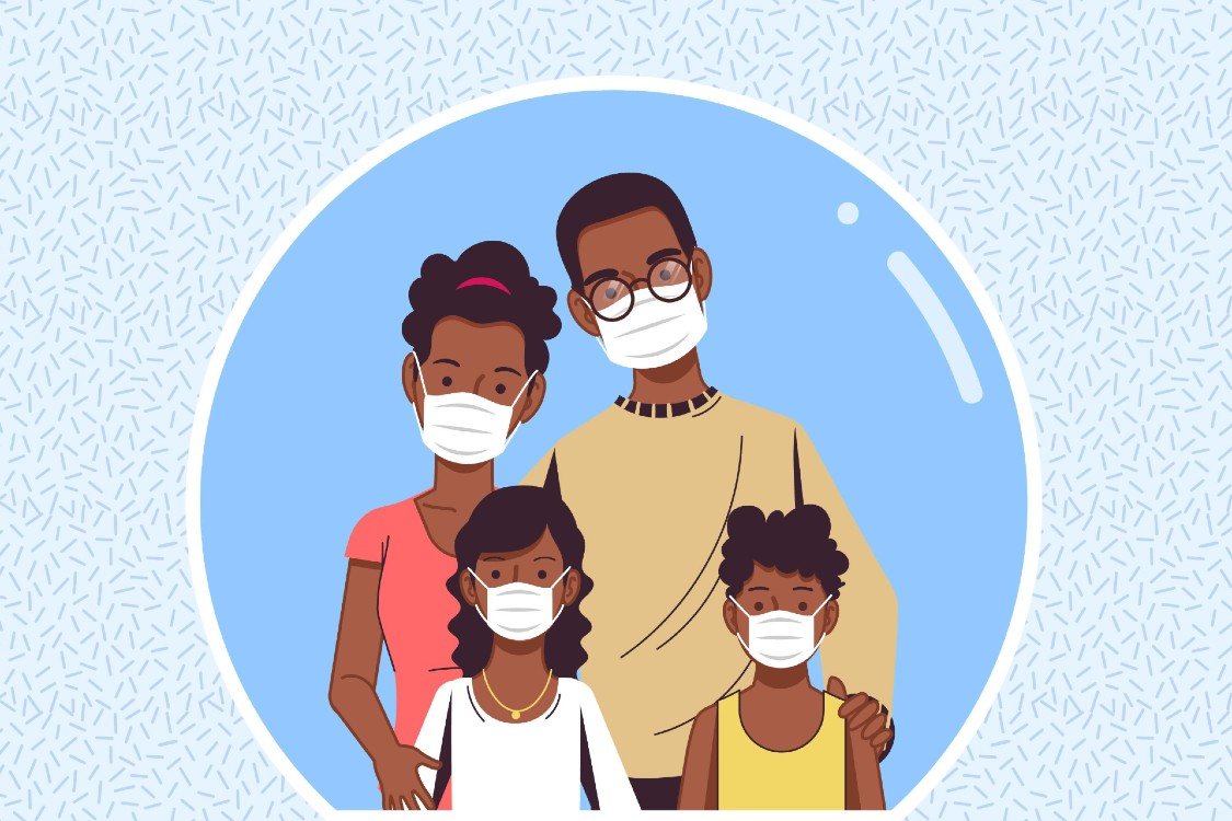 A family wearing medical masks inside a bubble.