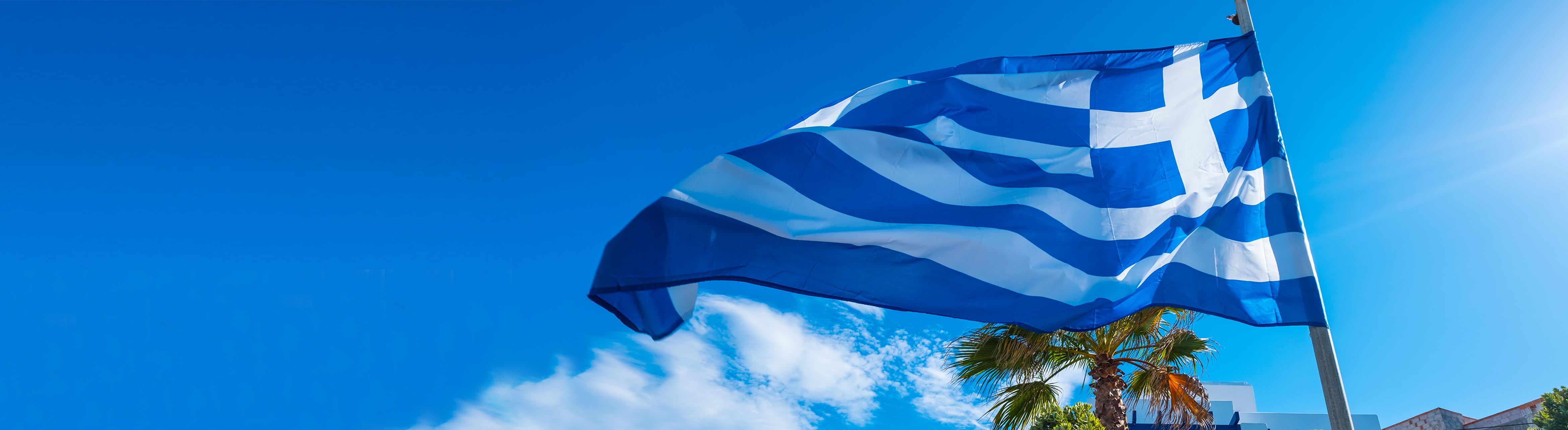Greek flag against a blue sky
