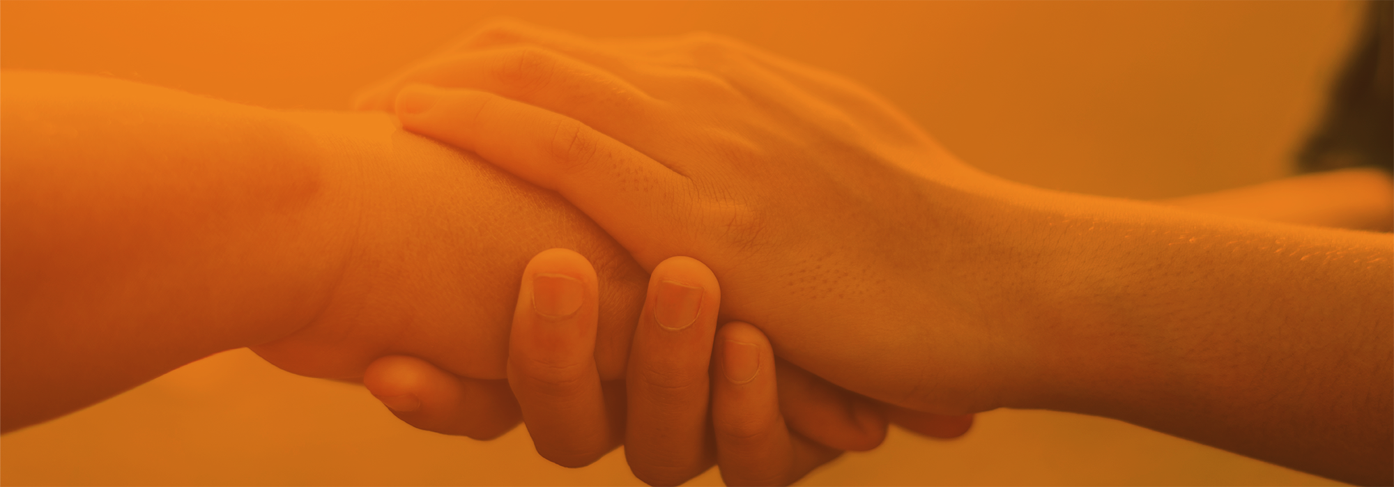 Hands holding each other in care