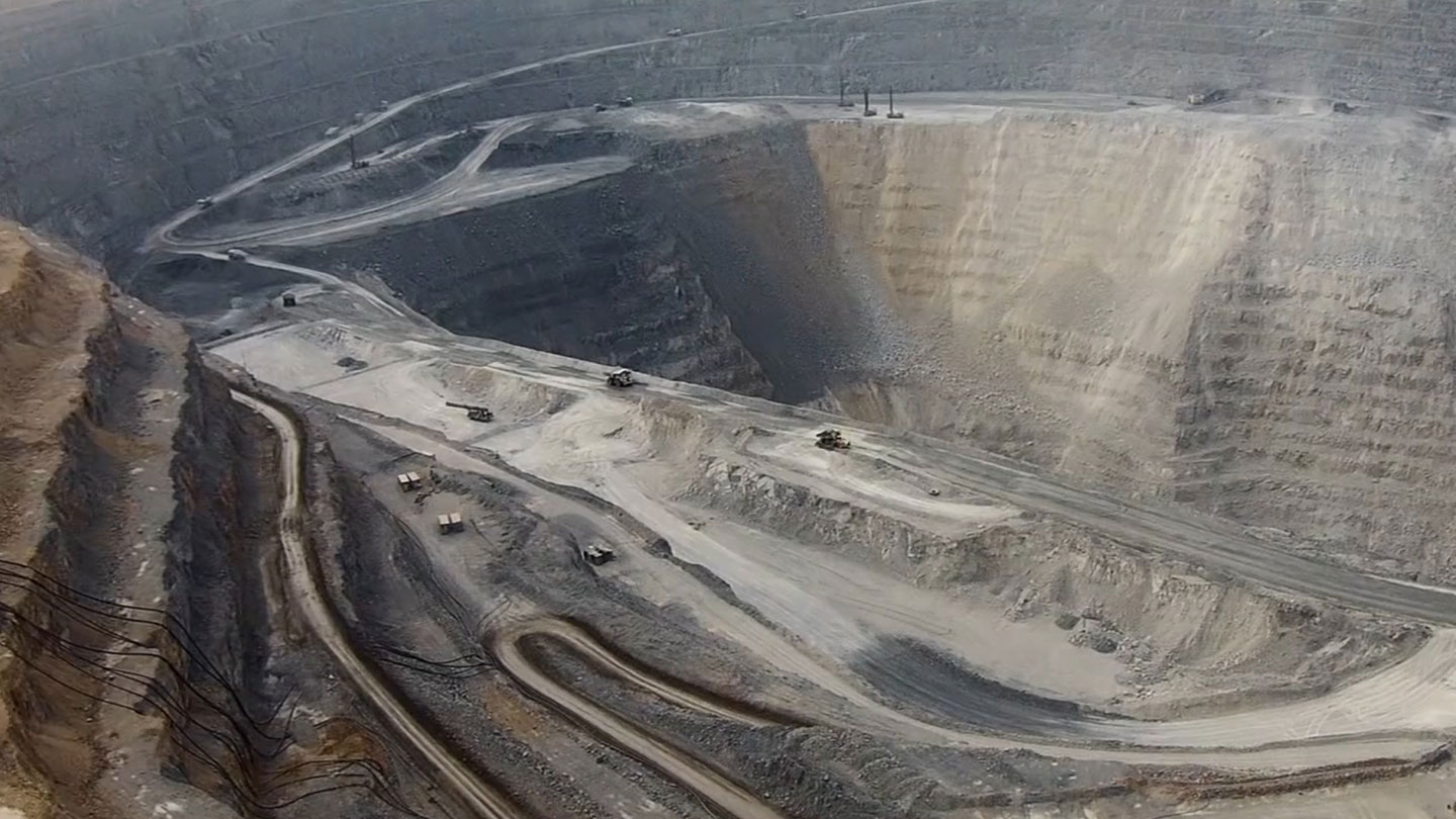Aerial view of large mine and mining operation.