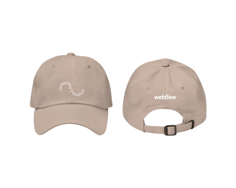 "A tan low profile, adjustable hat with a curved visor and curved texted on the front saying ""designing websites"" plus a small Webflow logo on the back."