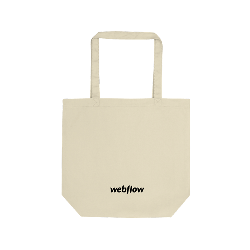 A tan cotton tote bag with a small black Webflow logo centered along the bottom.