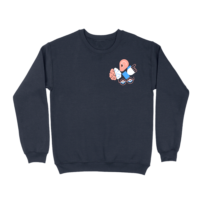 A navy crew neck sweatshirt with a cluster of illustrated icons representing an ear, brain, hand, and eyes in the upper right corner of the front.