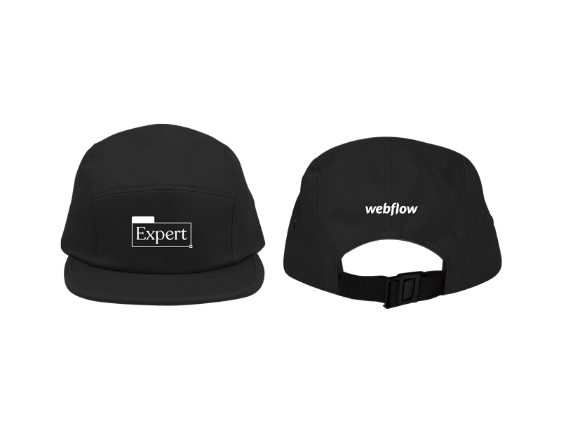 """A black camper-style cap with a low profile, nylon strap clip closure and a white embroidered design on the front saying """"Webflow Expert"""" along with a white Webflow logo on the back."""