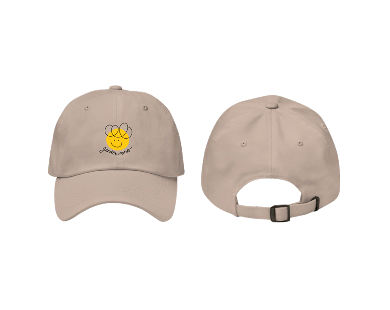 """A play on code, this classic cap features a friendly smiley face with the text """"gender:none"""" to represent the genderfluid and non-binary community. It's got a low profile fit with an adjustable strap and curved visor."""