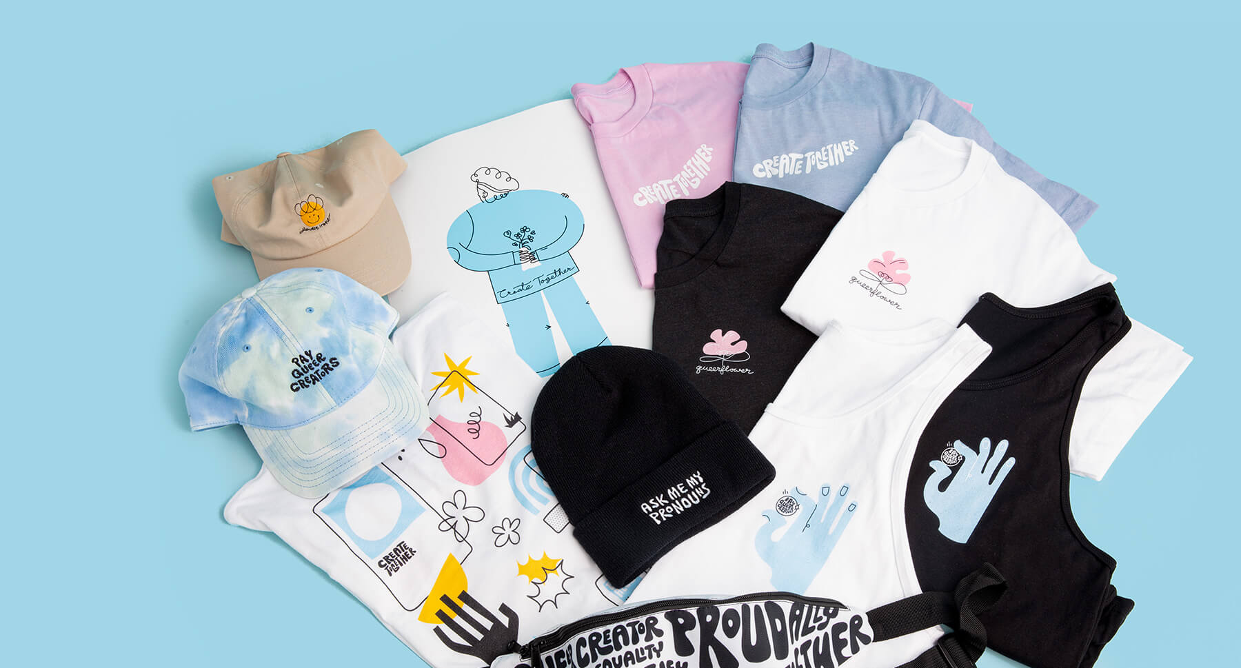 A pink t-shirt with a black and white tank top and a blue tie die hat laying on top of a light blue background