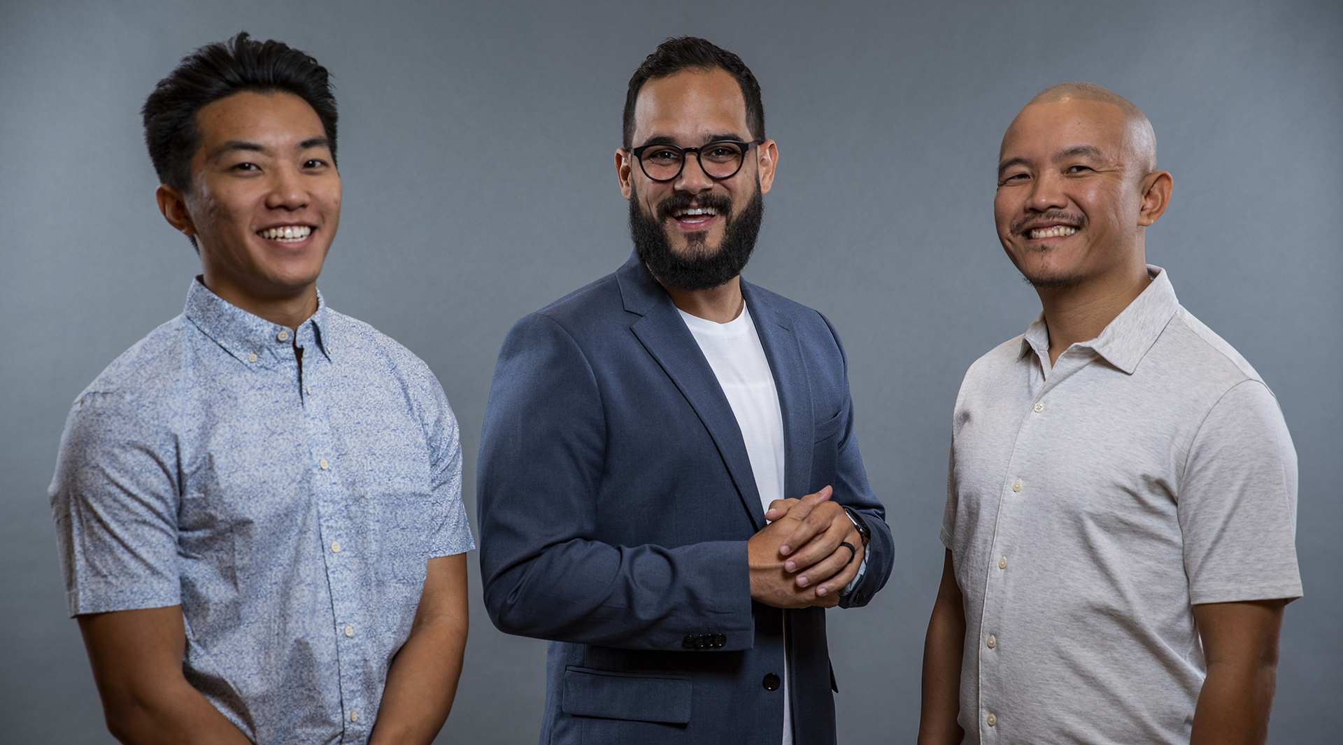 Welcome's founders, Roberto Ortiz, Jerry Shen and Tiger Shen in front of a light blue background.