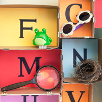Colourful shelves with letters and some items.