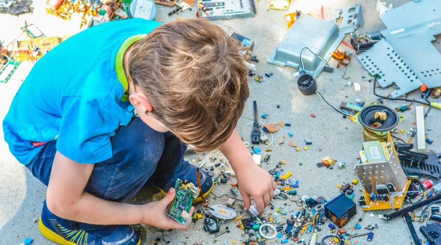 boy builds with lego on ground