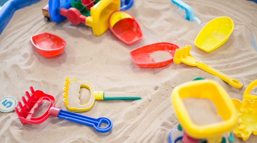 sandbox with brightly coloured toys