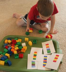 Boy playing with Lego bricks