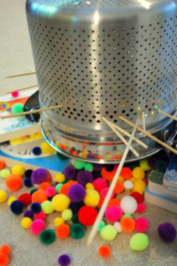 Picture of a colander and pompoms
