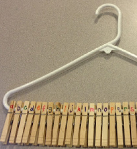 Picture of a white hanger with clothes pegs
