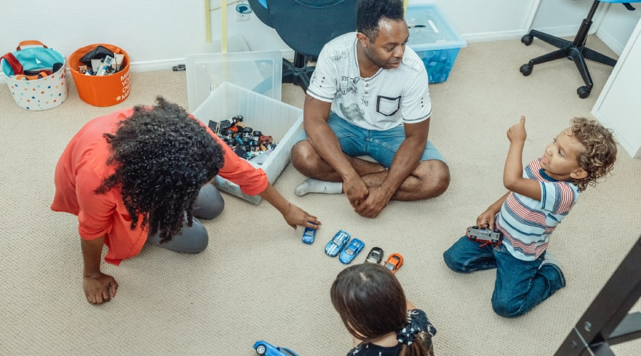 parents playing cars with children