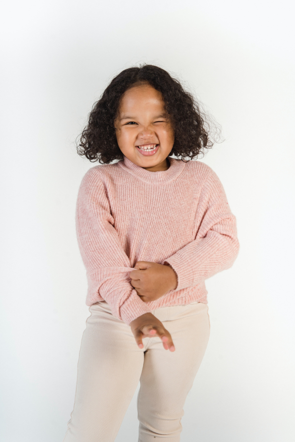 little girl laughing and winking